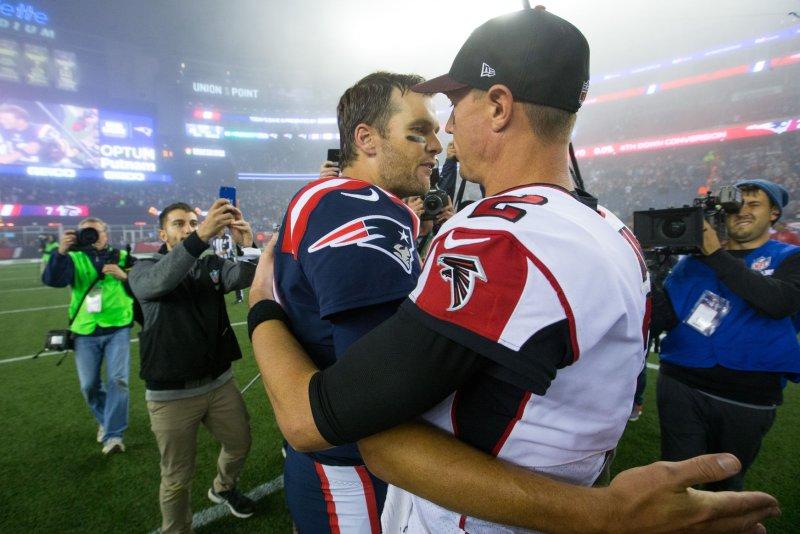 New England Patriots quarterback Tom Brady (12) hugs Atlanta Falcons quarterback Matt Ryan (2) after the Patriots defeated the Falcons 23-7 at Gillette Stadium in Foxborough, Massachusetts on October 22, 2017. File photo by Matthew Healey/UPI