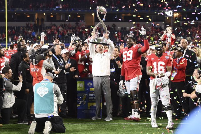 Ohio State Buckeyes head coach Urban Meyer (C) holds up the Cotton Bowl trophy after defeating the USC Trojans in the Goodyear Cotton Bowl Classic on December 29, 2017 at AT&T Stadium in Arlington, Texas. Photo by Shane Roper/UPI