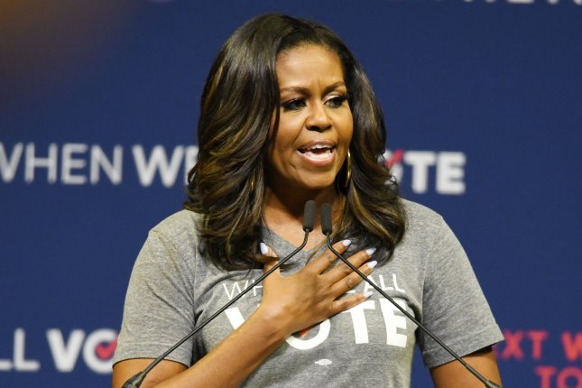 Former first lady Michelle Obama said she could never forgive President Donald Trump for risking her family's safety with his rhetoric. File Photo by Gary I Rothstein/UPI