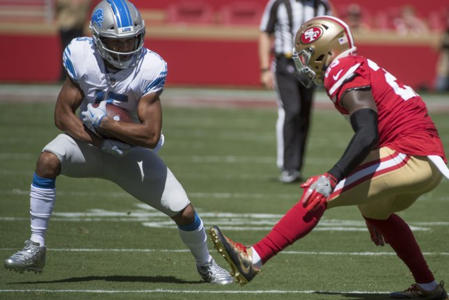Detroit Lions wide receiver Golden Tate (L) tries to elude San Francisco 49ers defender Jaquiski Tartt in the first quarter on September 16 at Levi's Stadium in Santa Clara, Calif. Photo by Terry Schmitt/UPI