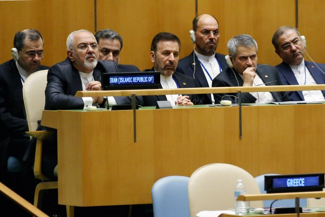 Iran's Foreign Minister Mohammad Javad Zarif, second left, listens along with delegates as Hassan Rouhani, president of Iran, speaks at the 73rd General Debate at the United Nations General Assembly in New York City on September 25, 2018. Photo by Monika Graff/UPI