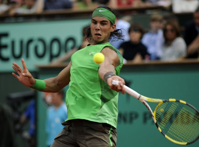 Rafael Nadal, shown during the French Open final, switched from clay to grass on Wednesday but still continued winning, taking a second-round match at the Artois Championships in London.