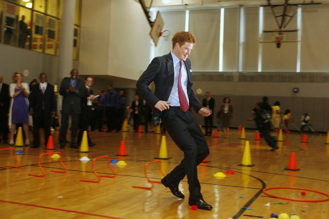 Prince Harry of Britain races in a gym during a tour of the Harlem Children's Zone school in the Harlem region of New York on May 30, 2009. (UPI Photo/Lucas Jackson/Pool)