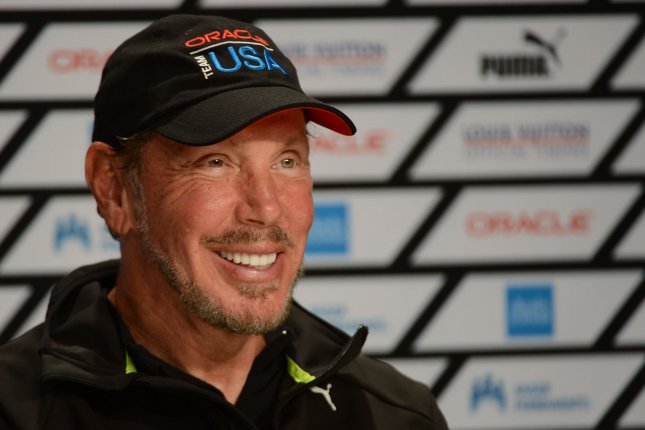 Oracle founder Larry Ellison smiles after Oracle Team USA won the final race of the America's Cup Regatta against Emirates New Zealand in San Francisco on September 25, 2013. UPI/Terry Schmitt