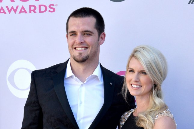 Derek Carr and Heather Neel attend the Country Music Awards in Las Vegas, Nevada on April 2, 2017. Photo by Jim Ruymen/UPI