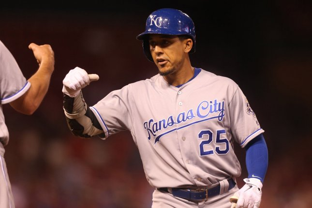 Kansas City Royals' Jon Jay pumps fists with first base coach Mitch Maier after hitting a two RBI single in the ninth inning against the St. Louis Cardinals on May 22 at Busch Stadium in St. Louis. Photo by Bill Greenblatt/UPI