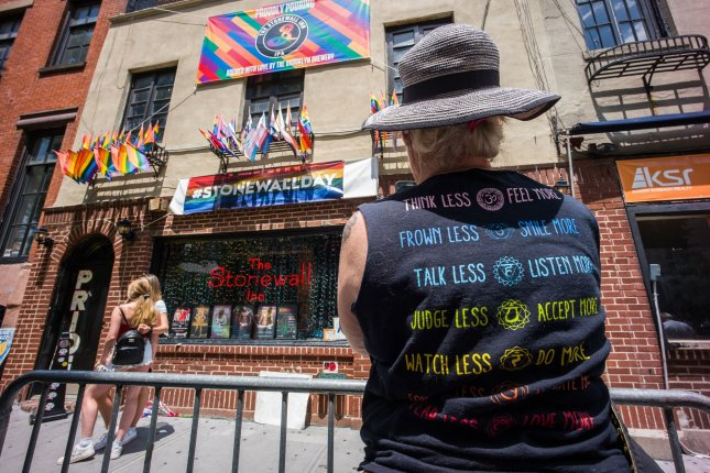 Tourists take pictures in front of the Stonewall Inn on the 50th anniversary of the Stonewall riots on Friday. Photo by Steve Ferdman/UPI