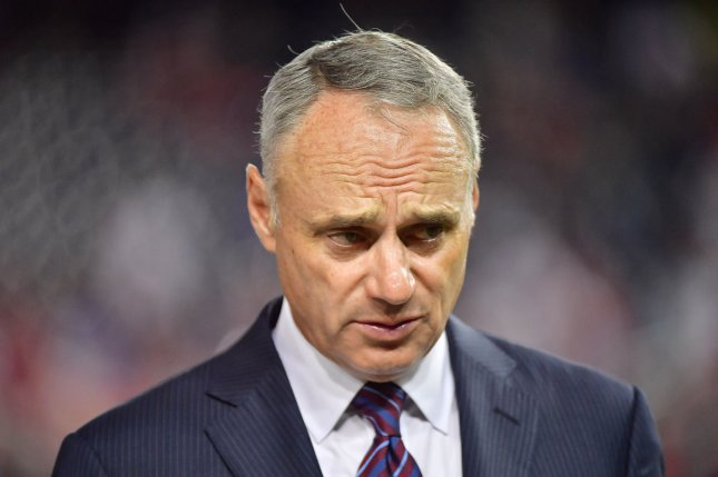 Major League Baseball commissioner Rob Manfred said there are many options on the table for when the league returns, including increased doubleheaders, fewer innings, fewer regular-season games and an altered post-season format. File Photo by Kevin Dietsch/UPI