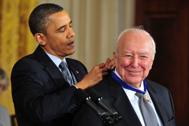 President Barack Obama awards the 2010 Presidential Medal of Freedom to artist Jasper Johns during a ceremony at the White House in Washington on February 15, 2011. Johns turns 90 on May 15. File Photo by Kevin Dietsch/UPI
