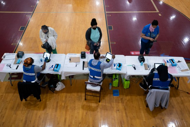 Voters wait to check in during the primary election at a polling location in Washington, D.C., on Tuesday. Photo by Kevin Dietsch/UPI