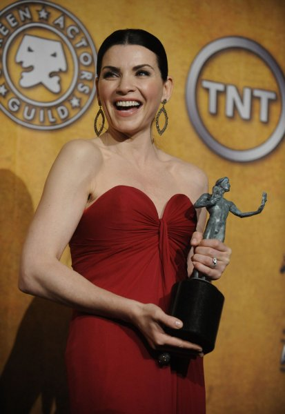 Julianna Margulies poses backstage after winning the female actor in a drama series award at the 17th annual Screen Actors Guild Awards held at the Shrine Auditorium in Los Angeles on January 30, 2011. UPI/Phil McCarten