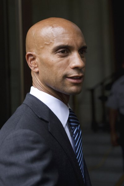 D.C. Mayor Adrian Fenty (L) responds to the US Supreme Court's ruling that struck down the city's handgun ban Washington on June 26, 2008. The Court ruled 5-4 that Americans have a Constitutional right to bear arms, but appears to leave many other laws and regulations in tact, in its first ruling on gun rights in 70 years. (UPI Photo/Patrick D. McDermott)