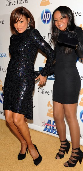 Singer Whitney Houston (L) and her daughter Bobbi Kristina Brown arrive at the Pre-Grammy Gala & Salute to Industry Icons with Clive Davis honoring David Geffen in Beverly Hills, California on February 12, 2011. UPI/Jim Ruymen