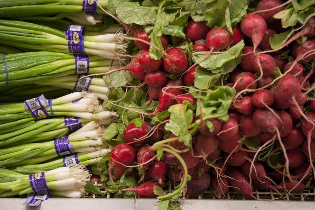 Onions and radishes are items in the produce section at the King Soopers supermarket in Lakewood, Colorado on June 20, 2012. UPI/Gary C. Caskey