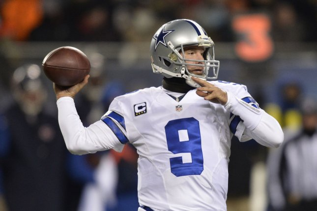 Dallas Cowboys quarterback Tony Romo throws a pass during the second quarter at Soldier Field in Chicago on December 9, 2013. (File/UPI/Brian Kersey)