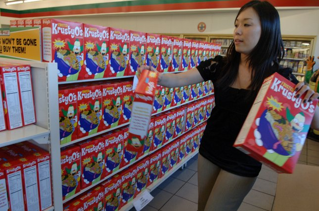 Alyson Kwok restocks the shelves with KrustyO's cereal at a 7-Eleven convenience store converted to a Kwik-E-Mart in Burbank, California on July 2, 2007. Over the weekend, 7-Eleven Inc. turned eleven stores into Kwik-E-Marts, the fictional convenience stores of The Simpsons fame, to promote the release later this month of The Simpsons Movie, in the latest example of marketers making life imitate art. The store sells items that until now existed only on television: Buzz Cola, KrustyO's cereal and Squishees, the slushy drink knockoff of Slurpees. It's all part of a campaign to hype the July 27 opening of The Simpsons Movie, the big-screen debut for the long-running television cartoon, which loves to lampoon 7-Eleven as a store that sells all kinds of unhealthy snacks and is run by a man with a thick Indian accent. (UPI Photo/Jim Ruymen)