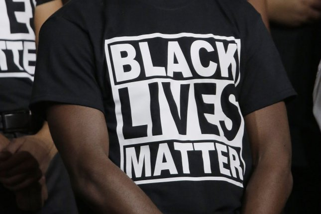 An attendee at the Democratic National Convention wears a Black Lives Matter T-shirt at the Wells Fargo Center in Philadelphia, Pennsylvania, on July 26. Monday, the Movement for Black Lives issued a policy platform that called for six core demands and 40 priorities intended to institute change and offset harm inflicted on disadvantaged black communities in the United States. Photo by Ray Stubblebine/UPI