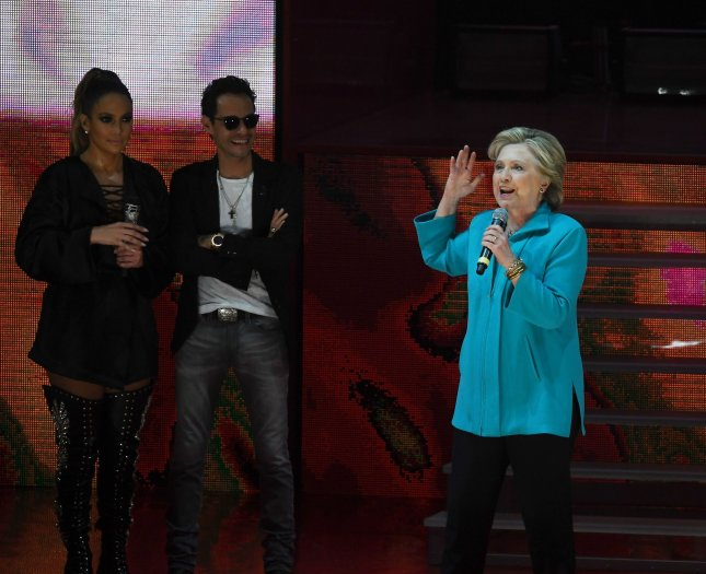Hillary Clinton, pictured Saturday night at a campaign rally in Miami with musical artists Jennifer Lopez and Marc Anthony, has called on the FBI to release emails found on a computer shared by disgraced former Rep. Anthony Weiner and his estranged wife, Huma Abedin, who is one of Clinton's top aides. The emails were discovered during an investigation into Weiner allegedly sexting with a 15-year-old and may relate to the investigation into Clinton's private email server the FBI closed in July. File photo by Gary I Rothstein/UPI