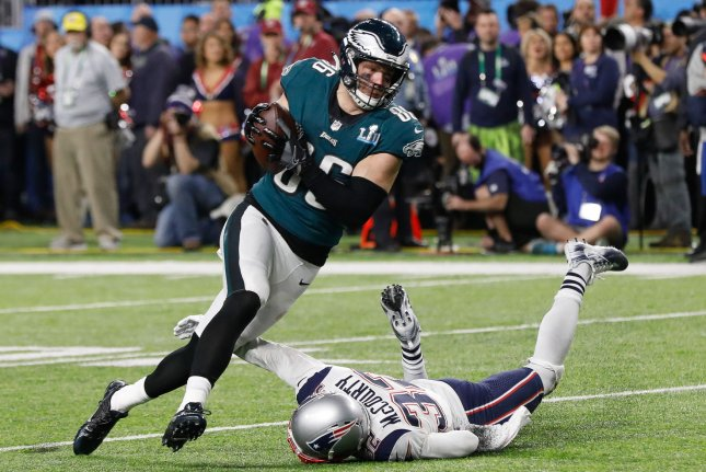 Philadelphia Eagles tight end Zach Ertz (86) makes the catch for a touchdown as New England Patriots safety Devin McCourty (32) reaches for the tackle while on the turf in the fourth quarter of Super Bowl LII on February 4, 2018 at U.S. Bank Stadium in Minneapolis, Minnesota. Photo by John Angelillo/UPI