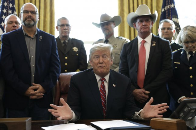 President Donald Trump talks to the media before signing his first veto, rejecting the bipartisan resolution that would undo his national emergency declaration. Photo by Yuri Gripas/UPI