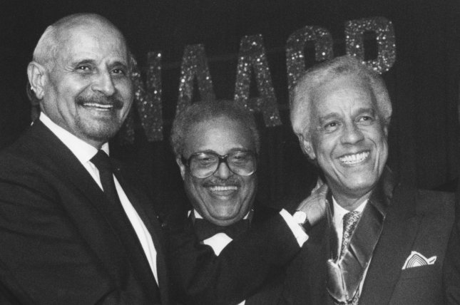 Virginia Gov. L. Douglas Wilder (R), beams upon receiving the 75th NAACP Spingarn Medal from former recipient Percy Ellis Sutten (L) of New York on July 12, 1990, in Los Angeles. On November 27, 1989, Wilder became the first elected African-American governor in the United States. File Photo by Jim Ruymen/UPI