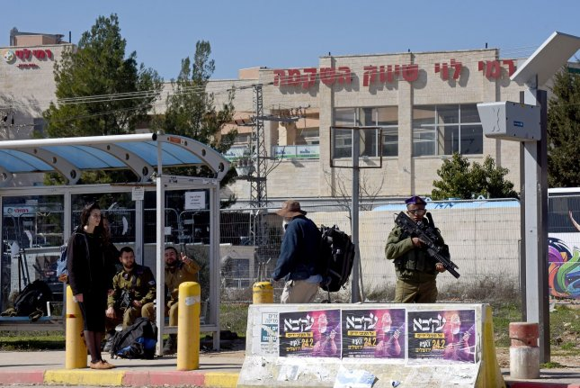 An Israeli soldier guards near the Gush Etzion shopping center on February 13 in the West Bank. Israeli police say they broke up a smuggling ring that sent ammunition into the Palestinian territories. File Photo by Debbie Hill/UPI