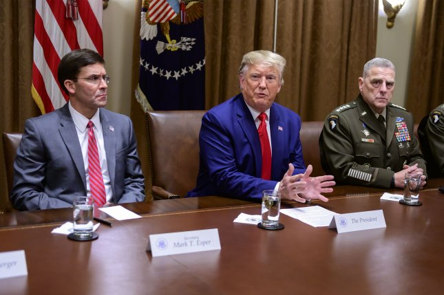 United States Secretary of Defense Dr. Mark T. Esper, left, and Chairman of the Joint Chiefs of Staff Gen. Mark A. Milley, right, shown here with President Donald J. Trump in October 2019, briefed the president Monday on a proposal for reducing the number of troops permanently stationed in Germany. Photo by Ron Sachs/UPI