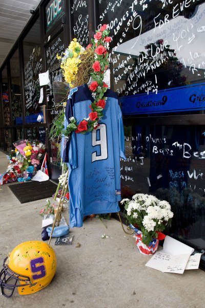 Pieces of fan memorabilia are left to mourn the death of former Tennessee Titans quarterback Steve McNair outside his Gridiron 9 restaurant in Nashville, Tennessee on July 6, 2009. McNair was found dead with several gunshot wounds in a Nashville condominium on Saturday, July 4. (UPI Photo/Frederick Breedon IV)