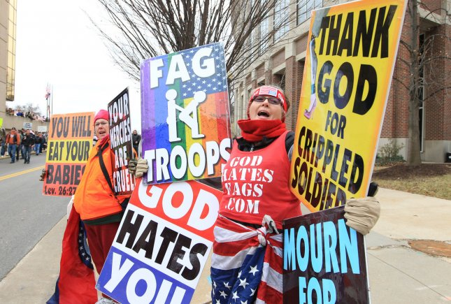 Two members from the Westboro Baptist Church of Topeka, Kansas, begin their chants on a street corner in St. Charles, Missouri as those disagreeing with their views, walk down the street to greet them on January 6, 2011. The church which preaches against all form of sin, is known for showing up at military funerals to drive home their anti-gay point. St. Charles County has passed a law that the Westboro Baptist Church demonstrators must be atleast 300 feet from any military funeral or burial. The law is now being challanged in Federal court by the ACLU. UPI/Bill Greenblatt