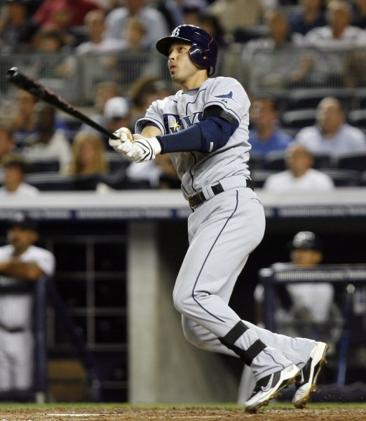 Tampa Bay Rays Jason Bartlett hits a solo homer in the eighth inning against the New York Yankees at Yankee Stadium in New York, Sept. 8, 2009. UPI/John Angelillo