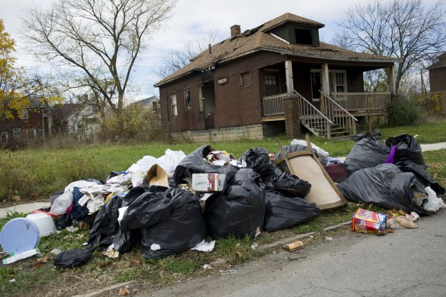 A pile of trash is seen in front of an abandon house in Detroit on October 27, 2012. UPI/Kevin Dietsch