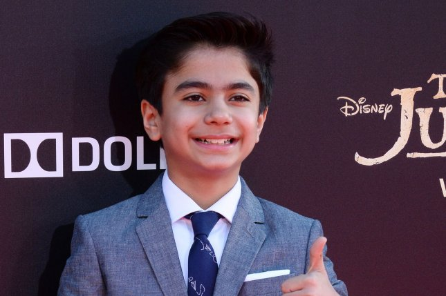 Cast member Neel Sethi attends the premiere of the motion picture fantasy The Jungle Book in Los Angeles on April 4, 2016. Photo by Jim Ruymen/UPI