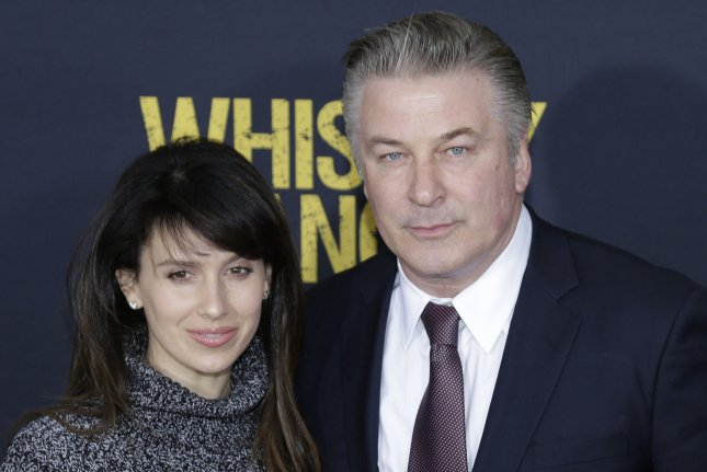 Alec Baldwin (R) and Hilaria Baldwin at the New York premiere of Whiskey Tango Foxtrot on March 1. The couple welcomed their third child this week. File Photo by John Angelillo/UPI