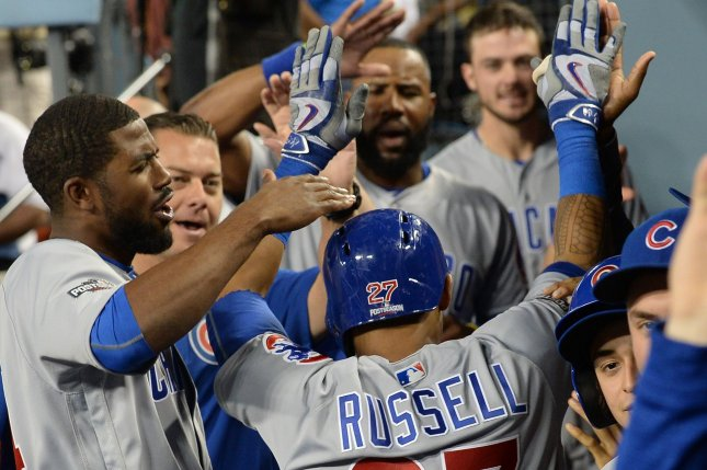 Chicago Cubs shortstop Addison Russell (C) receives high fives in the dugout after hitting a two-run home run against the Los Angeles Dodgers during the sixth inning in game five of the National League Championship Series at Dodgers Stadium on October 20, 2016. Chicago and Los Angeles are tied 2-2 in the NLCS. Photo by Jim Ruymen/UPI