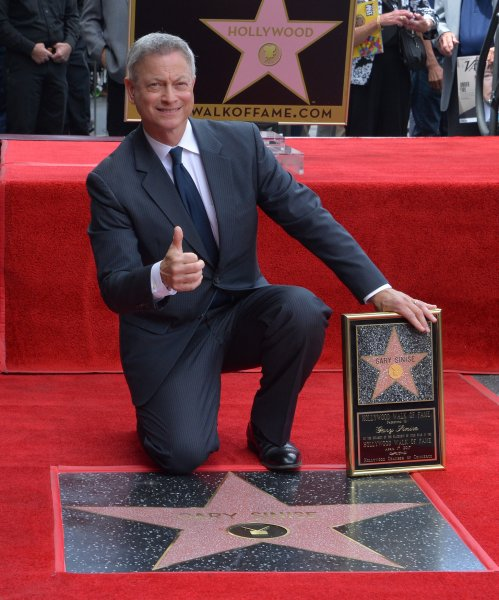 Actor and director Gary Sinise holds a replica plaque during an unveiling ceremony honoring him with the 2,606th star on the Hollywood Walk of Fame in Los Angeles on April 17. Photo by Jim Ruymen/UPI
