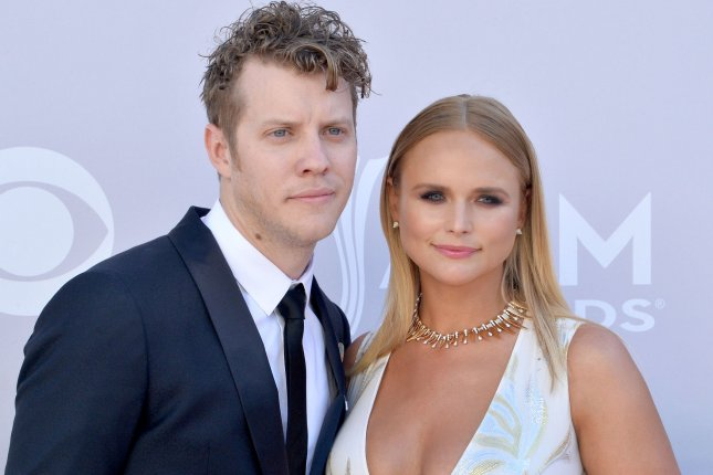 Miranda Lambert (R) and Anderson East attend the Academy of Country Music Awards on April 2. The country star opened up about East in the August issue of Cosmopolitan. File Photo by Jim Ruymen/UPI