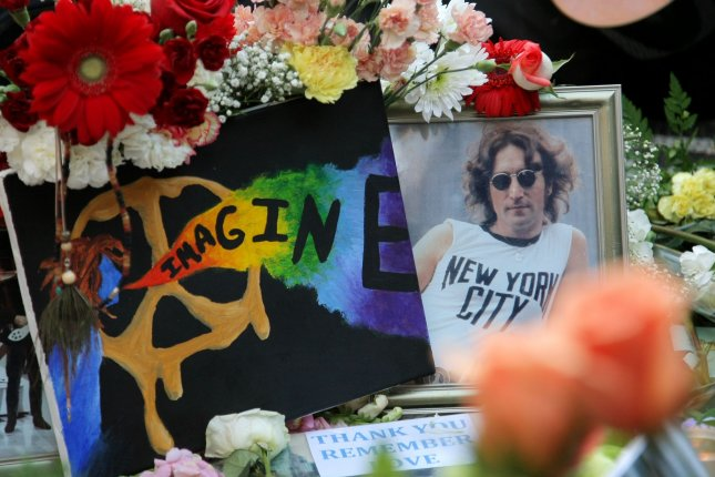 A picture of John Lennon is among the many items placed on the Imagine mosaic as fans gather at Strawberry Fields in Central Park to pay tribute to the musician on December 8, 2010 in New York City. On August 24, 1981, Mark Chapman, who claimed devils forced him to kill Lennon and God told him to confess, was sentenced to 20 years to life in prison for the fatal shooting. File Photo by Monika Graff/UPI