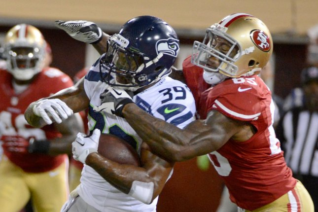 Former Seattle Seahawks cornerback Brandon Browner (39) intercepts a pass by ex-San Francisco 49ers quarterback Alex Smith in the fourth quarter on October 18, 2012 at Candlestick Park in San Francisco. File photo by Terry Schmitt/UPI