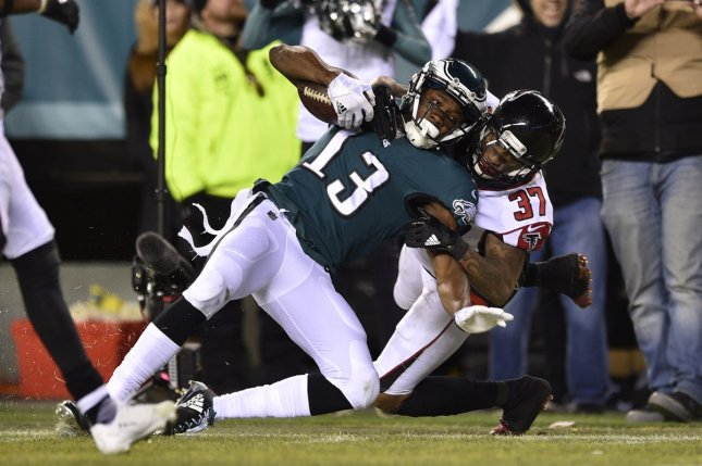 Philadelphia Eagles wide receiver Nelson Agholor (13) is tackled by Atlanta Falcons safety Ricardo Allen (37) during the second quarter of the NFC Divisional Round on January 13, 2018 at Lincoln Financial Field in Philadelphia. Photo by Derik Hamilton/UPI