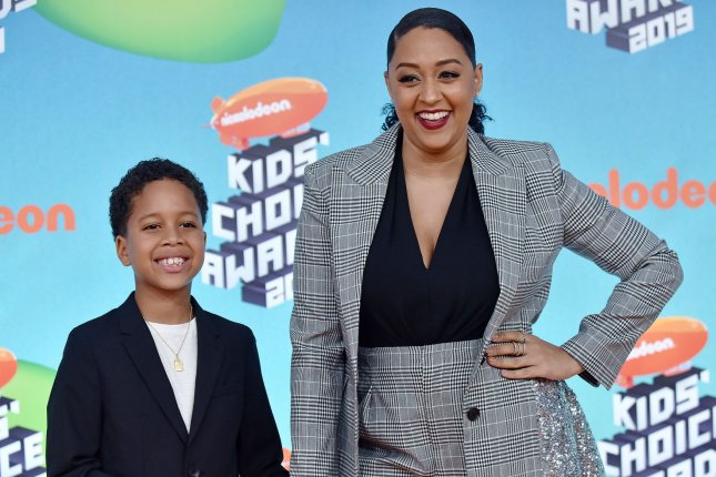 Tia Mowry (R), pictured with son Cree, shared some of her mother's experiences with racism in a post promoting change. File Photo by Christine Chew/UPI