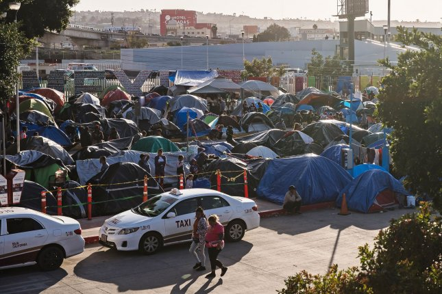 Hundreds of asylum seekers set up tents by the port of entry at El Chaparral Plaza in Tijuana, Mexico, on March 26. File Photo by Ariana Drehsler/UPI