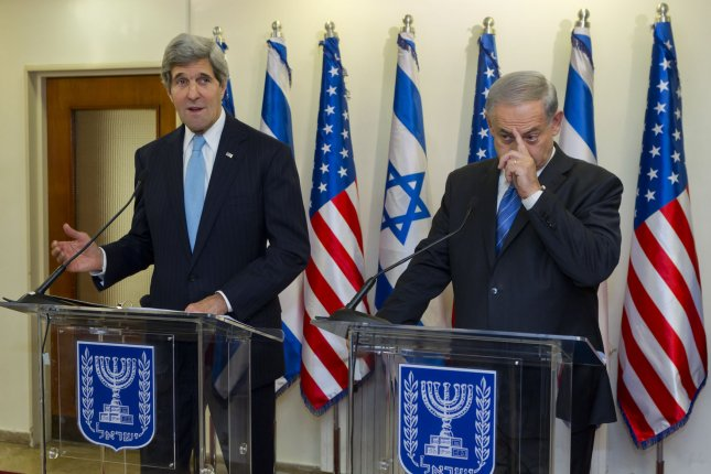 U.S. Secretary of State John Kerry (L) alongside Israeli Prime Minister Benjamin Netanyahu as the two deliver statements prior to holding a meeting in the Israeli leader's Jerusalem offices on January 2, 2014. Kerry spoke of bringing about a 'framework agreement' between the Israelis and Palestinians as he begins his 10th visit to negotiate peace talks between the two sides. UPI/Jim Hollander/Pool