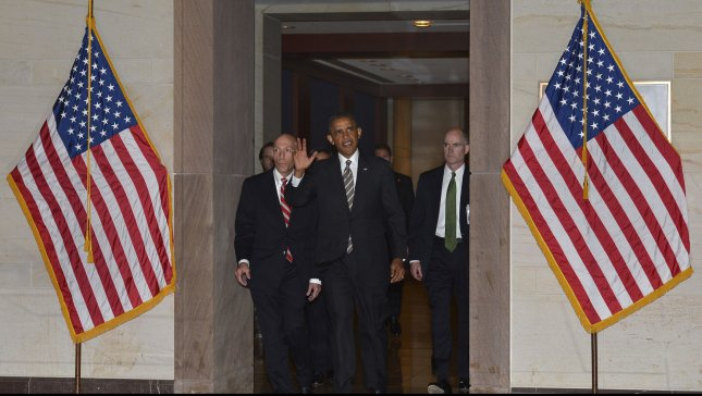 US President Barack Obama waves to the presss as he arrives at the US Capitol for talks with House Democrats, July 31, 2013, in Washington, DC. UPI/Mike Theiler