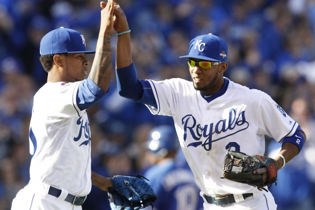 Kansas City Royals Yordano Ventura (L) high fives shortstop Alcides Escobar after a diving catch catch by Escobar of a liner by Toronto Blue Jays Russell Martin lead to a double play in the second inning of game 2 of the American League Championship Series at Kauffman Stadium in Kansas City, Missouri on October 17, 2015. Photo by Jeff Moffett/UPI
