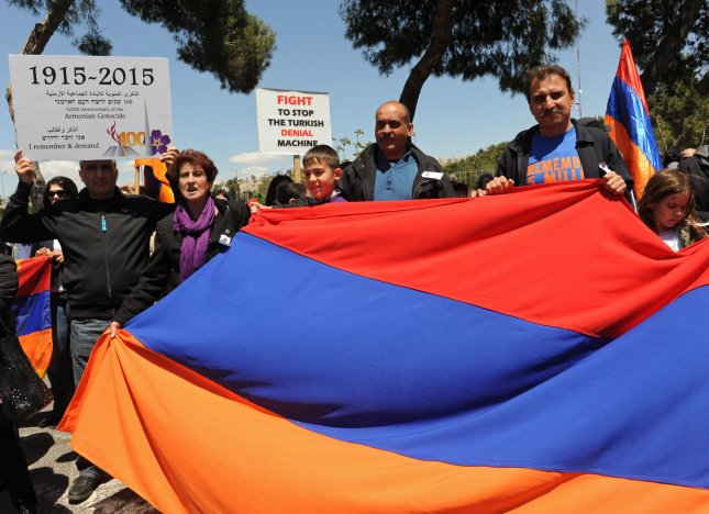 Eleven Turkish German MPs have been placed under police protection after voting in support of the a resolution that declared the 1915 slaughter of Armenians by the Ottoman Turks as a genocide. Here, Armenians protest behind an Armenian flag outside the Turkish Consulate in Jerusalem last year on the 100th anniversary of the Armenian massacre. File Photo by Debbie Hill/UPI