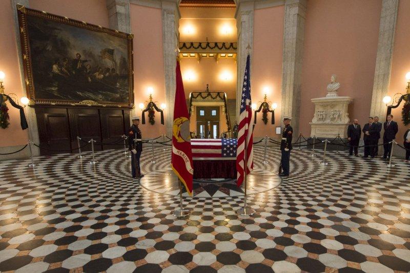 Former astronaut and U.S. senator John Glenn lies in repose, under a United States Marine honor guard, in the rotunda of the Ohio Statehouse in Columbus, Ohio, on Friday. NASA Photo by Bill Ingalls/UPI