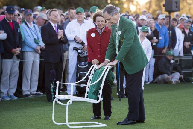 Augusta National Chairman Billy Payne and Kathleen Kit Palmer, the wife of the late Arnold Palmer, place Palmer's green jacket on a chair during the ceremonial first tee shot on the first day of the 2017 Masters Tournament at Augusta National Golf Club in Augusta, Georgia on April 6, 2017. Palmer passed away in September of last year at the age of 87. Photo by Kevin Dietsch/UPI