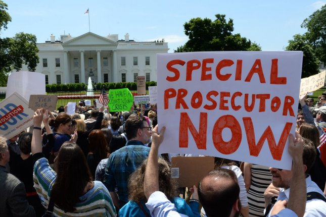Demonstrators protest against President Donald Trump in front of the White House on Wednesday for his firing of FBI Director James Comey, the man who'd led the Justice Department's investigation of potential Russian interference with the 2016 presidential election. Photo by Pat Benic/UPI
