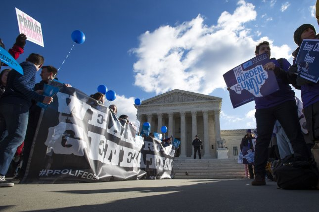Judge temporarily halts Texas ban on common second-trimester abortion procedure