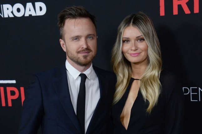 Aaron Paul (L) and Lauren Paul attend the Los Angeles premiere of Triple 9 on February 16, 2016. File Photo by Jim Ruymen/UPI